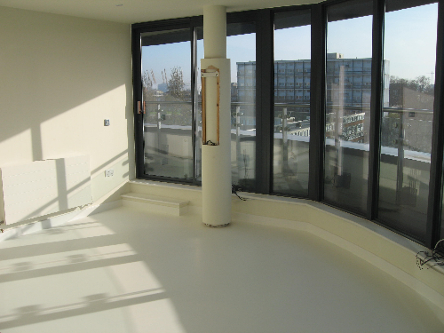 White poured flooring West London poured rubber floor