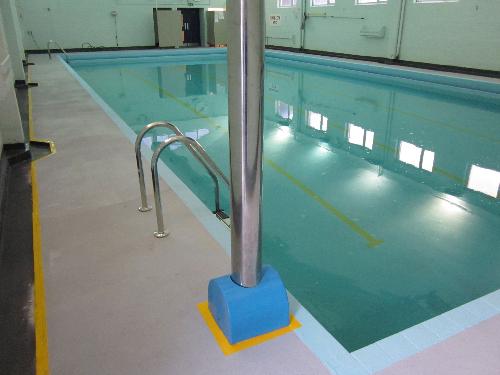 Anti slip polyaspartic resin flooring systems